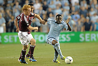Sporting midfielder Peterson Joseph (19) goes past Jeff Larentowicz..Sporting Kansas City defeated Colorado Rapids 2-0 in Open Cup play at LIVESTRONG Sporting Park, Kansas City, Kansas.