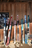 USA, Utah, Midway, Soldier Hollow, cross country skiis lined up against the wall of the ski lodge