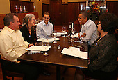 "United States President Barack Obama dines with campaign supporters who won the June 2011 ""Dinner with Barack"" contest, at The Liberty Tavern restaurant in Arlington, Virginia, October 27, 2011. Shown, left to right, are Ken Knight, Wendi Smith, Casey Helbling, the President, and Juanita Martinez..Credit: Martin Simon / Pool via CNP"