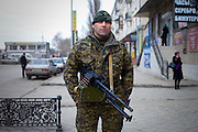 "Ali, a member of Yug (South) battalion, one of the few so-called ""ethnic"" units manned exclusively by ethnic Chechens, is on duty in downtown Grozny the day before presidential elections in Russia. Grozny, Chechnya, Russia, 2012"