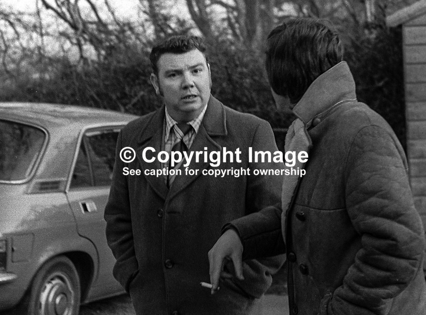 Sam McCormack, member, UDA, Ulster Defence Association, facing camera, after attending a meeting regarding local policing at Stormont Castle. 27th February 1975. 197502270164SMC<br /><br />Copyright Image from Victor Patterson, 54 Dorchester Park, <br />Belfast, UK, BT9 6RJ<br /><br />t1: +44 28 9066 1296 (from Rep of Ireland 048 9066 1296)<br />t2: +44 28 9002 2446 (from Rep of Ireland 048 9002 2446)<br />m: +44 7802 353836<br /><br />victorpatterson@me.com<br />www.victorpatterson.com<br /><br />Please see my Terms and Conditions of Use at VICTORPATTERSON.COM. It is IMPORTANT that you familiarise yourself with them.<br /><br />Images used on the Internet must be visibly watermarked i.e. &copy;VICTORPATTERSON.COM within the body of the image and copyright metadata must not be deleted. Images used on the Internet have a size restriction of 4kbs and are chargeable at the then current NUJ rates.<br /><br />This image is only available for the use of the download recipient i.e. television station, newspaper, magazine, book publisher, etc, and must not be passed on to any third party. It is also downloaded on condition that each and every usage is notified within 7 days to victorpatterson@me.com<br /><br />The right of Victor Patterson to be identified as the author is asserted in accordance with The Copyright Designs And Patents Act (1988).
