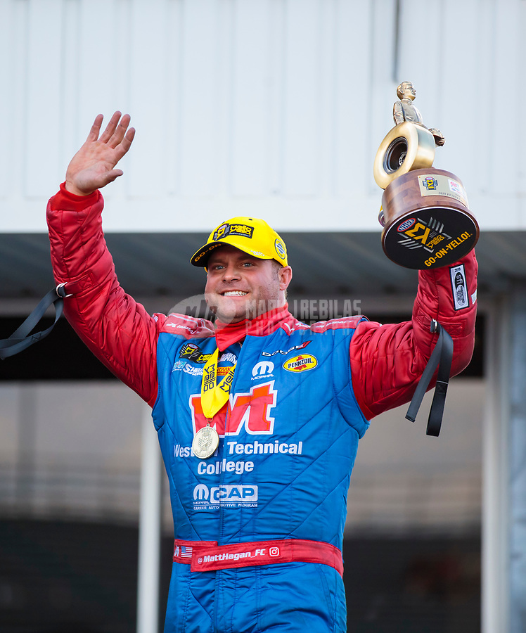 Oct 20, 2019; Ennis, TX, USA; NHRA funny car driver Matt Hagan celebrates after winning the Fall Nationals at the Texas Motorplex. Mandatory Credit: Mark J. Rebilas-USA TODAY Sports