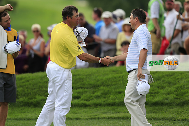 Lee Westwood (ENG) and Tim Clark (RSA) finish their match on the 18th green during Thursday's Round 1 of the 95th US PGA Championship 2013 held at Oak Hills Country Club, Rochester, New York.<br /> 8th August 2013.<br /> Picture: Eoin Clarke www.golffile.ie