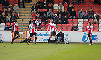 William Boyle of Cheltenham Town (centre) celebrates scoring his side's first goal during the Sky Bet League 2 match between Cheltenham Town and Grimsby Town at the The LCI Rail Stadium,  Cheltenham, England on 17 April 2017. Photo by PRiME Media Images / Mark Hawkins.