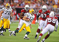 Aug. 28, 2009; Glendale, AZ, USA; Green Bay Packers quarterback (12) Aaron Rodgers runs the ball in the first half against the Arizona Cardinals during a preseason game at University of Phoenix Stadium. Mandatory Credit: Mark J. Rebilas-
