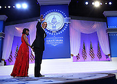United States President Barack Obama waves supporters after he danced with first lady Michelle Obama during the Inaugural Ball January 21, 2013 at Walter E. Washington Convention Center in Washington, DC. Barack Obama was re-elected for a second term as President of the United States.  .Credit: Alex Wong / Pool via CNP
