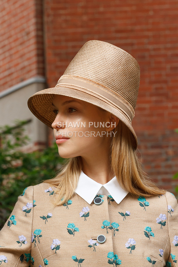 """Model poses in an outfit by Lela Rose and Rocha Millinery hat by Rosael Torres Davis, for the Lela Rose Resort 2018 """"Garden Party"""" collection presentation in Jefferson Market Garden on June 7 2017, during Resort Fashion Week in New York City."""