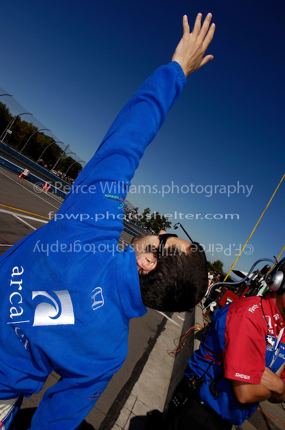 23-25 September,2005, Watkins Glen,New YorkUSA.Praise the Lord! No, Dario Franchitti streches out prior to qualifying..Copyright©F.Peirce Williams 2005.