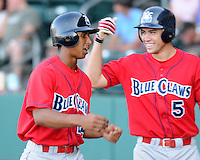 July 29, 2009: Outfielder Anthony Gose (24) of the Lakewood BlueClaws is congratulated by Travis D'Arnaud after hitting a home run in a game at Fluor Field at the West End in Greenville, S.C. Photo by: Tom Priddy/Four Seam Images