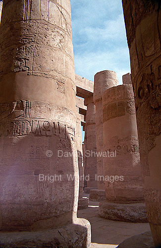Columns in Karnak Temple in Luxor, Egypt with hieroglyphics illuminated by the sun..