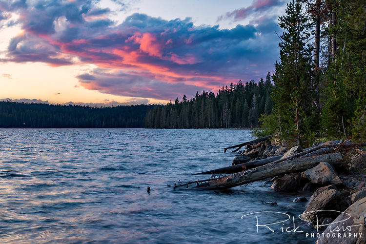 Storm clouds over Juniper Lake are illuminated by the setting sun Lassen Volcanic National Park.