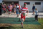 Jamie Gilbert-Clark leads out the Karaka team for the Counties Manukau Premier Club Rugby game between Karaka and Onewhero, played at Karaka, on Saturday April 26 2014. Karaka won the game 26 - 23 after trailing 7 - 8 at halftime  Photo by Richard Spranger