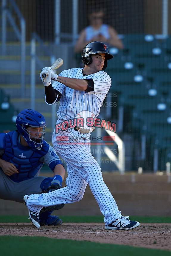 Surprise Saguaros shortstop Tyler Wade (12) at bat during an Arizona Fall League game against the Glendale Desert Dogs on October 23, 2015 at Salt River Fields at Talking Stick in Scottsdale, Arizona.  Glendale defeated Surprise 9-6.  (Mike Janes/Four Seam Images)