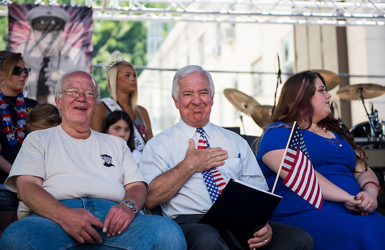 UNITED STATES - JULY 5: Logan Mayor Serafino Noletti, left, and Rep. Nick Rahall, D-W.Va., sit on stage before speaking to the crowd at the West Virginia Freedom Festival in downtown Logan, W. Va., on July 5, 2014. (Photo By Bill Clark/CQ Roll Call)