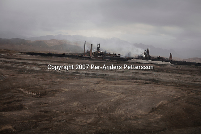 LANZHOU, CHINA JUNE 9: A steel factory stands in a rural area between Lanzhou and Xian on June 9, 2007 outside Lanzhou, China. Many areas of China are heavily polluted with coal-fueled factories. (Photo by Per-Anders Pettersson)..