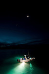 Richard Fitzpatrick and Dr. Jamie Seymour in their research boat looking for box jellyfish at night using strong lights to attract and see them.