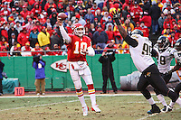 Chiefs quarterback Trent Green throws a pass over the rushing Jacksonville Jaguars tackle Marcus Stroud during the second quarter at Arrowhead Stadium in Kansas City, Missouri on December 31, 2006. The Chiefs won 35-30.