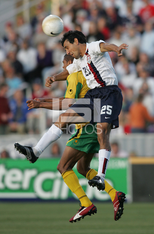 APR 11, 2006: Cary, North Carolina:  USMNT midfielder (25) Pablo Mastroeni heads the ball while playing Jamaica during a friendly at the SAS Soccer Park in Cary, North Carolina