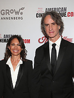 BEVERLY HILLS, CA - NOVEMBER 8: Jay Roach, Susanna Hoffs, 33rd American Cinematheque Award Presentation Honoring Charlize Theron at The Beverly Hilton Hotel in Beverly Hills, California on November 8, 2019. Credit Faye Sadou/MediaPunch