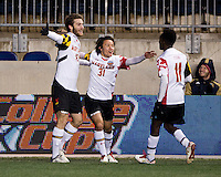 Patrick Mullins (15) of Maryland celebrates his goal with teammate Tsubasa Endoh (31) during the NCAA Men's College Cup semifinals at PPL Park in Chester, PA.  Maryland defeated Virginia, 2-1.
