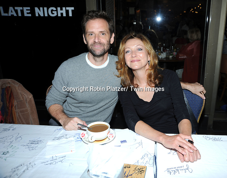 Malcolm Getz and Julie White posing for photographers at The Broadway Cares/ Equity Fights Aids 24th Annual Broadway Flea Market & Grand Auction on September 26, 2010 in Shubert Alley..photo by Robin Platzer/ Twin Images.212-935-0770