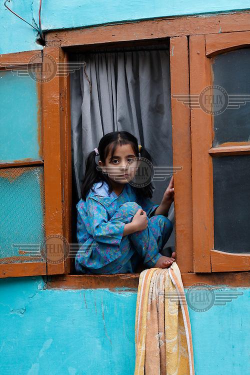 Girl in window. Srinagar, Kashmir,India. © Fredrik Naumann/Felix Features