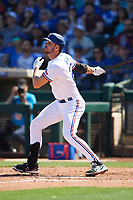 Greg Bird (20) of the Texas Rangers follows through on a swing during a Cactus League Spring Training game against the Los Angeles Dodgers on March 8, 2020 at Surprise Stadium in Surprise, Arizona. Rangers defeated the Dodgers 9-8. (Tracy Proffitt/Four Seam Images)