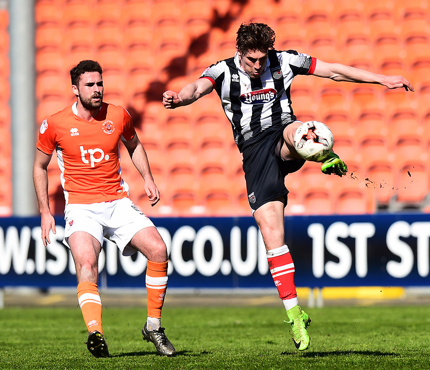 Grimsby Town's Sam Jones beats Blackpool's Clark Robertson to the ball<br /> <br /> Photographer Richard Martin-Roberts/CameraSport<br /> <br /> The EFL Sky Bet League Two - Blackpool v Grimsby Town - Saturday 8th April 2017 - Bloomfield Road - Blackpool<br /> <br /> World Copyright &copy; 2017 CameraSport. All rights reserved. 43 Linden Ave. Countesthorpe. Leicester. England. LE8 5PG - Tel: +44 (0) 116 277 4147 - admin@camerasport.com - www.camerasport.com