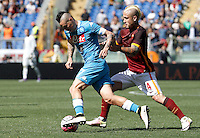 Calcio, Serie A: Roma vs Napoli. Roma, stadio Olimpico, 25 aprile 2016.<br /> Napoli&rsquo;s Marek Hamsik, left, is challenged by Roma&rsquo;s Radja Nainggolan during the Italian Serie A football match between Roma and Napoli at Rome's Olympic stadium, 25 April 2016. <br /> UPDATE IMAGES PRESS/Isabella Bonotto