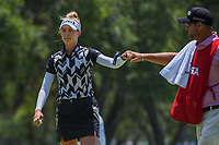 Nelly Korda (USA) fist bumps her caddie after sinking her putt on 7 during round 1 of the 2019 US Women's Open, Charleston Country Club, Charleston, South Carolina,  USA. 5/30/2019.<br /> Picture: Golffile | Ken Murray<br /> <br /> All photo usage must carry mandatory copyright credit (© Golffile | Ken Murray)
