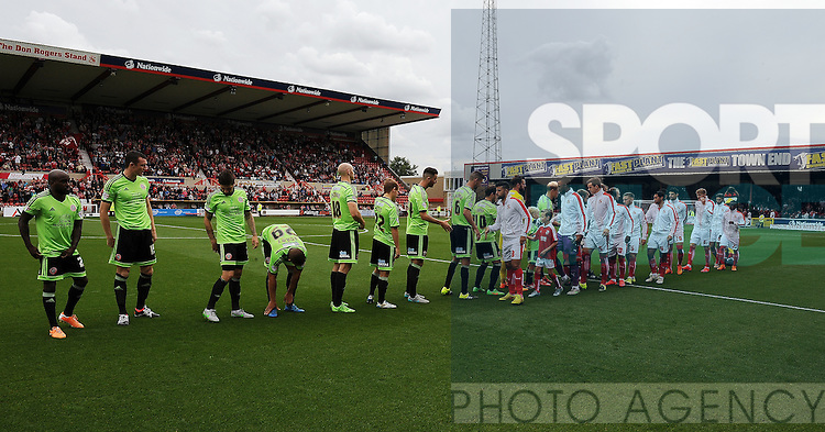 The Swindon Town team shakes hands with the Sheffield United team before the start of the match<br /> - English League One - Swindon Town vs Sheffield Utd - County Ground Stadium - Swindon - England - 29th August 2015