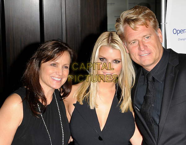 TINA SIMPSON, JESSICA SIMPSON & JOE SIMPSON.arriving at Operation Smile at the Beverly Hilton Hotel in Beverly Hills, California, USA, October 2nd 2009..portrait headshot halterneck black buttons mother father parents dad mom mum daughter family married husband wife .CAP/ROT.©Lee Roth/Capital Pictures.