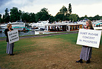 Henley Music Festival Henley on Thames Oxfordshire. Women holding signs saying Quiet Please Concert in Progress. 1990s UK
