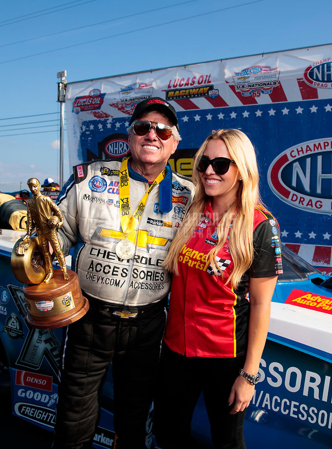 Sep 2, 2019; Clermont, IN, USA; NHRA funny car driver John Force celebrates with daughter Brittany Force after winning the US Nationals at Lucas Oil Raceway. Mandatory Credit: Mark J. Rebilas-USA TODAY Sports