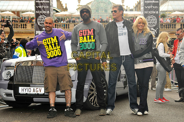 SHANE LYNCH, DAVID HASSELHOFF & HAYLEY ROBERTS .The start of Gumball 3000, Covent Garden, London, England. .May 26th, 2011.full length couple jeans denim black jacket grey gray purple brown shorts hands posing.CAP/CAS.©Bob Cass/Capital Pictures.