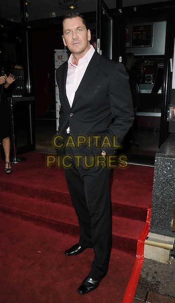 "CRAIG FAIRBRASS .attending the ""Devil's Playground"" DVD premiere, Prince Charles Cinema, Leicester Square, London, England, UK, October 3rd 2010..full length black suit white shirt hands in pockets .CAP/CAN.©Can Nguyen/Capital Pictures."