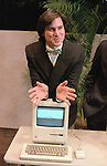 "Steven Jobs, chairman of the board of Apple Computer, leans on the new ""Macintosh"" personal comptuer following a shareholder's meeting Jan. 24, 1984 in Cupertino, Ca.  The Macintosh, priced at $2,495, is challenfing IBM in the personal computer market. (AP Photo/Paul Sakuma)"