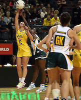 25.10.2012 Australia's Madison Browne and South Africa's Bongiwe Msomi in action during the England v Australia netball test match as part of the Quad Series played at the TSB Arena Wellington. Mandatory Photo Credit ©Michael Bradley.