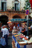Produce, shoppers and vendors at an open air market. France.