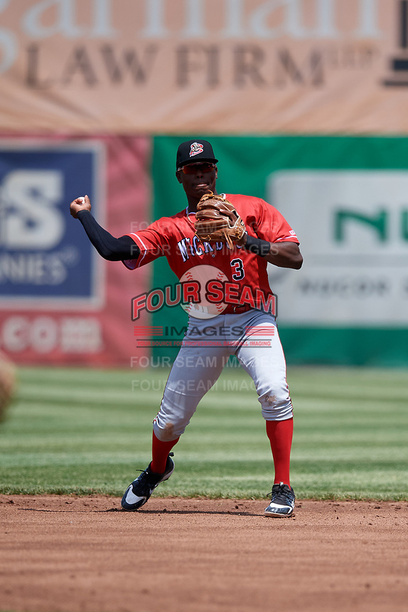 Batavia Muckdogs second baseman Demetrius Sims (3) throws to first base during a game against the Auburn Doubledays on June 17, 2018 at Falcon Park in Auburn, New York.  Auburn defeated Batavia 10-6.  (Mike Janes/Four Seam Images)