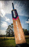 BNPS.co.uk (01202 558833)<br /> Pic: MikeKinsey/BNPS                                <br /> <br /> A village cricket club has turned a beloved tree that has stood on the boundary of their ground for 125 years into a giant carving of a cricket bat after it was condemned.<br /> <br /> The 16ft tall wooden bat took a tree surgeon and an assistant 18 months to carve after members of Shobrooke Park Cricket Club couldn't bring themselves fell the storm-damaged Scots Pine.<br /> <br /> The tree was planted on the eastern edge of the boundary when the club in Crediton, Devon, was established in 1890 and has been a feature ever since.