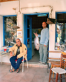 GREECE, Patmos, Skala, Dodecanese Island, taverna owner Yannis Kaneli shops at the fish market for his restaurant, Taverna Tzivaeri