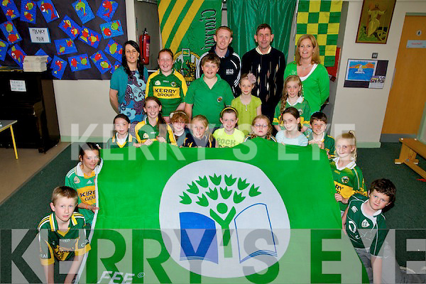 GREEN FLAG: St Brendan's NS Fenit who were presented with the Green Flag on Thursday helping out were, Mike O'Sullivan (chairperson), Caroline O'Connor (Teacher) Colm Cooper (Kerry football special guest) and the principal of St Brendan's NS Fenit........