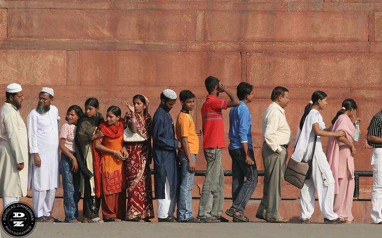 Visitors to the Red Fort in Delhi, India line up at a security line to enter the tourist attraction.  Construction of the fort, ordered by Shah Jahan, began in 1638 and completed in 1648.  Photograph by Douglas ZImmerman