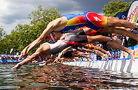 25 JUL 2010 - LONDON, GBR - Javier Gomez (top) and Courtney Atkinson dive into the water with the rest of the mens field at the start of the London round of the ITU World Championship Series mens triathlon (PHOTO (C) NIGEL FARROW)