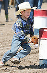 Jason Smith of Fallon competes in the Pee-Wee Stick Horse Barrel Racing event at the Fallon Junior Rodeo.  Photo by Tom Smedes.