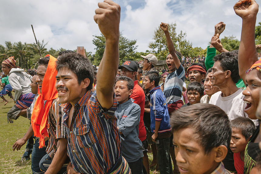 The crowds cheers as their warrior hit the enemy forces during the Pasola in the village of Wainyapu, Kodi. Pasola is an ancient tradition from the Indonesian island of Sumba. Categorized as both extreme traditional sport and ritual, Pasola is an annual mock horse warfare performed in response to the harvesting season. In the battelfield, the Pasola warriors use blunt spears as their weapon. However, fatal accident still do occurs.