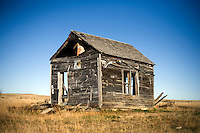 An old farmhouse stands on the Coffee Ranch outside Sumatra, Montana, USA.