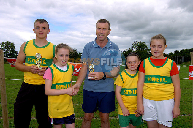 James Kirwan, Lisa Barry, Aine Mc Cormack and Emma Barry recieve thier winning trophies from Austin Tiernan at Boyne Athletic club sports day at Meadowview. Photo: Colin Bell / Newsfile