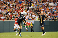 Gabriel Obertan (26) of Manchester United and Jordan Harvey (2) of the Philadelphia Union get tangled up going for a header. Manchester United (EPL) defeated the Philadelphia Union (MLS) 1-0 during an international friendly at Lincoln Financial Field in Philadelphia, PA, on July 21, 2010.